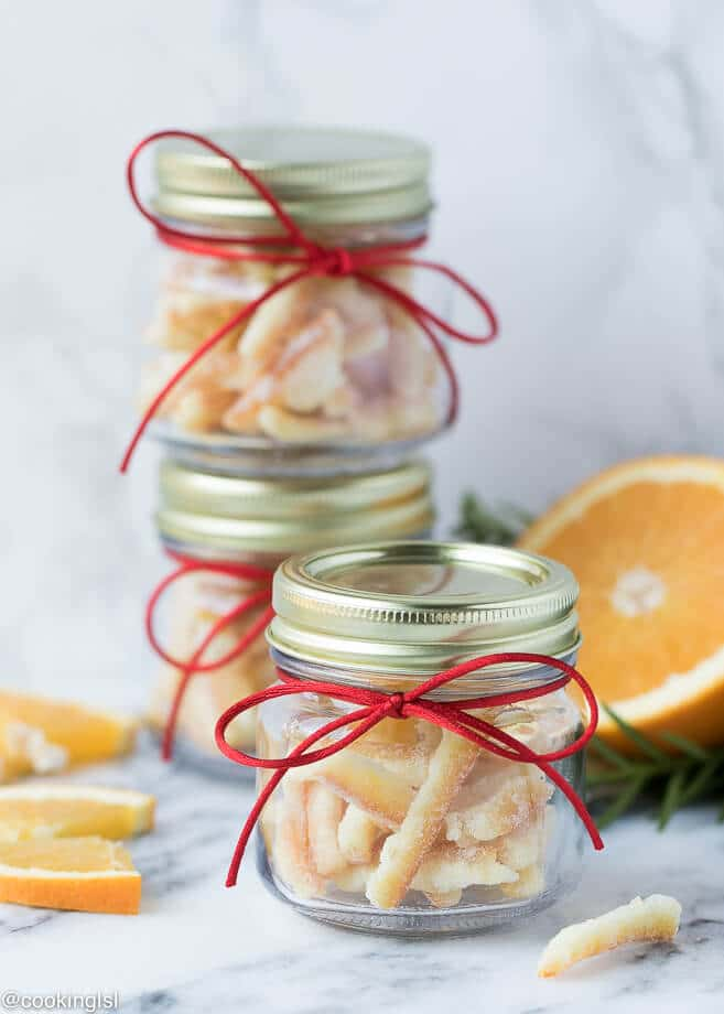 Small glass jars, filled with easy candied orange peel. Perfect for an edible holiday gift.