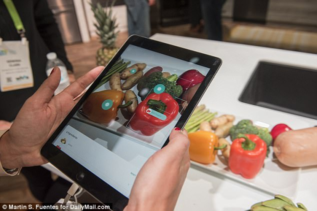 Yummly has unveiled a new app at CES that can scan the items in your fridge and recommend recipes based on what you have, even taking your preferences and dietary restrictions into account. Above, it can be seen scanning and labeling each food item on the table