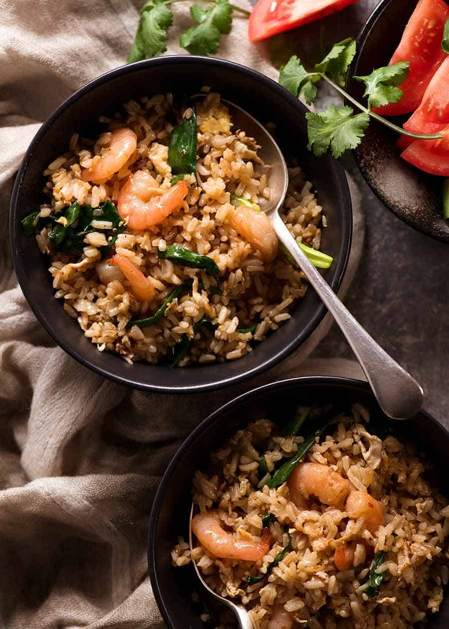 Two bowls of Thai Fried Rice, ready to be eaten
