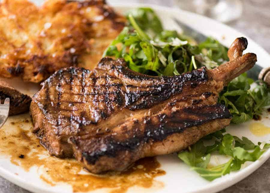 Grilled chops on a plate, made using a great Pork Chop Marinade